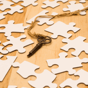 Key with Puzzle Pieces